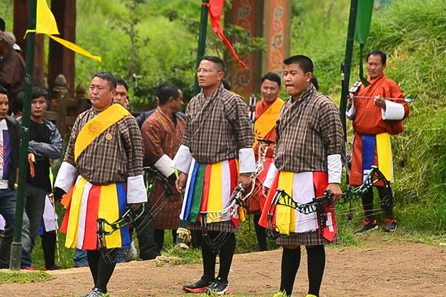 Watch an archery tournament in Bhutan