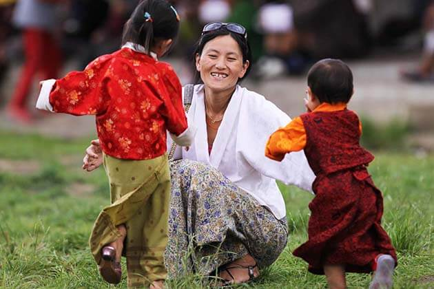 happy bhutan people - best bhutan honeymoon